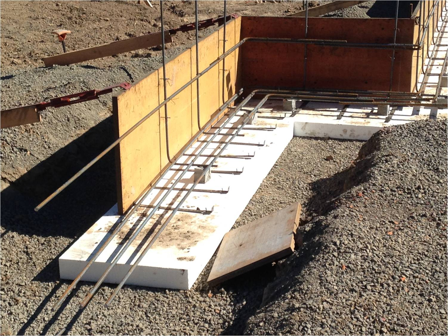 Walsh construction co placing a concrete foundation on for Foam basement forms