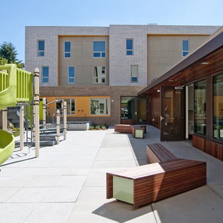 The building features two outdoor play areas